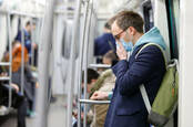 coronovirus: man covers face on public transport