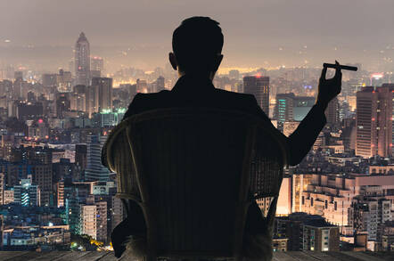 Generic rich guy looking over a nice city night-time view with a cigar