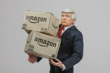 A model of Donald Trump carrying Amazon boxes
