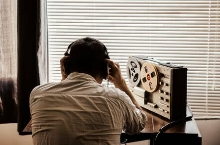 An officer listening to a wiretap