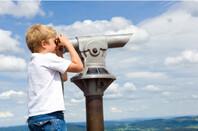 Boy using viewpoint binoculars
