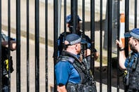 Police men and security guards with automatic weapons guns stand talking in London's Westminster (seat of UK government). Pic: Kristi Blokhin/shutterstock