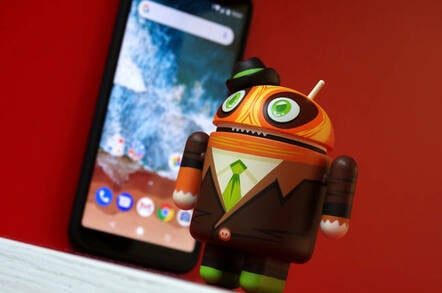Android in a suit in front of mobile phone