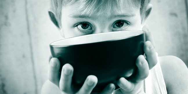 Hungry kid holding out bowl