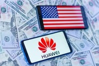 Phones showing US flag and Huawei logo