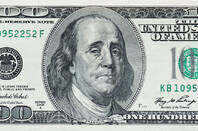 Benjamin Franklin crying on a $100 bill