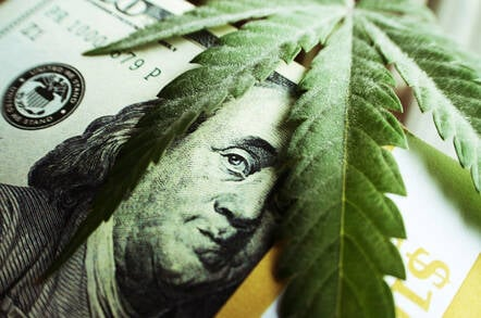 Marijuana leaves over money