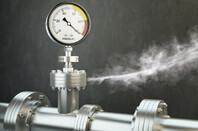 Gas or steam leaking from an industrial pressure gauge