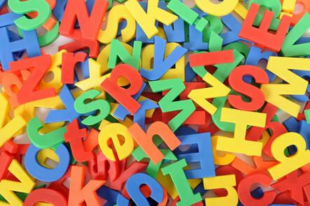 A mix of bright plastic fridge-magnet letters