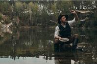 Gold prospector in river