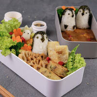 sushi penguins in containers