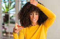 woman eats pizza