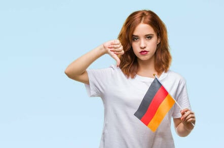 Someone holding a German flag with their thumb down