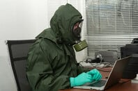 Bloke in office wearing hazmat suit
