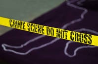 A mock up of a crime scene with a do-not-cross tape