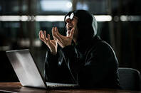 evil hacker cackles at sky while wearing inevitable black hoodie