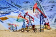 American oil drills set in front of $100 bills