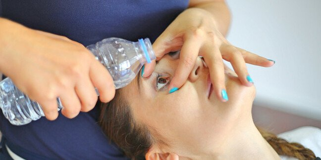 Woman getting eye washed out