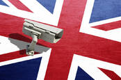 A CCTV camera against the UK flag
