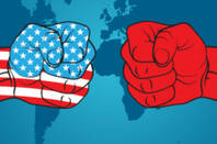Two cartoon fists representing US and China facing each other