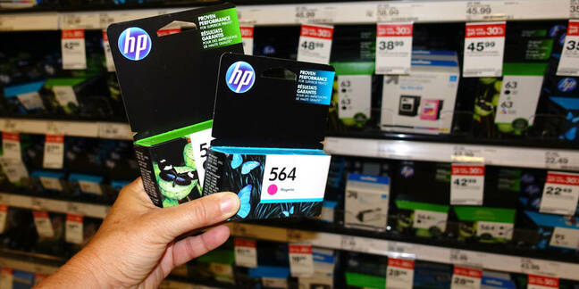 Someone holding some HP ink cartridges