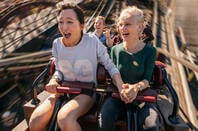 Two people enjoying a rollercoaster ride