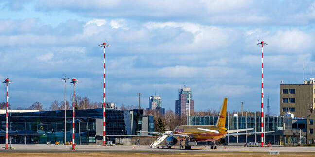 Riga, Latvia - March 19, 2020  a courier plane lands at a partially closed Riga International Airport