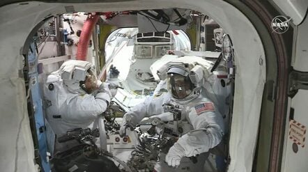 Spacewalkers Bob Behnken (left) and Chris Cassidy (right) in the Quest Airlock before beginning today's spacewalk. Credit: NASA TV