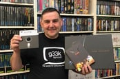 "Jason Fitzpatrick with the Limted Edition backers edition of Elite Dangerous and an original 5.25"" Floppy disk from the early '80s"