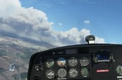 A spot of low-level Visual Flight Rules over Bedfordshire in Microsoft Flight Simulator 2020. Note the instruments' reflection on the cockpit canopy