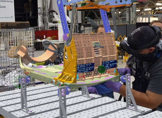 Lockheed Martin technicians at the NASA Michoud Assembly Facility use HoloLens 2 to assemble Orion's crew seats for the Artemis II mission. This image, captured with a HoloLens 2 headset, shows the holographic instructions overlaid on the crew seats. Image courtesy of Lockheed Martin.