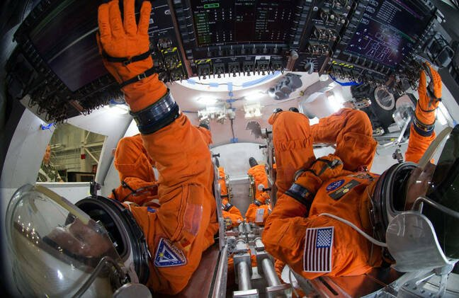Technicians used HoloLens 2 devices to assemble the crew module seats, similar to these seats in a mockup of the Orion spacecraft, for the first Orion mission to carry astronauts into space. Image courtesy of NASA.