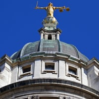 Lady Justice statue on top of the Old Bailey in London