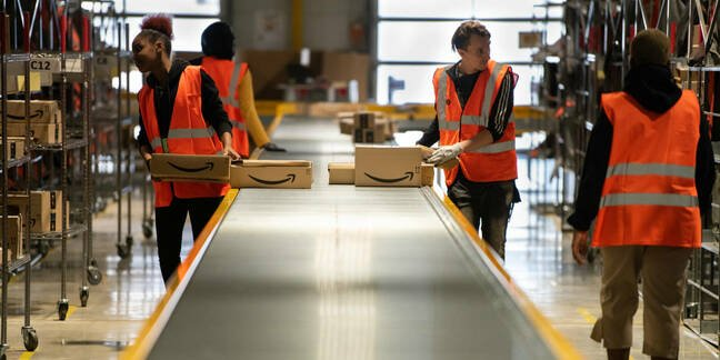 Amazon workers in Vélizy-Villacoublay in France sorting packages in late 2019