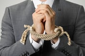 Businessman with hands tied