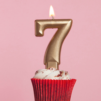 Number 7 gold candle in a cupcake