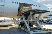 cargo loading with high loader at airport