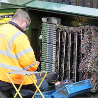 Chorleywood, Hertfordshire, England, UK - March 7th 2020: BT Openreach engineer working at cabinet box. Openreach is a functional division of the telecommunications company BT plc.