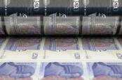 printing press making UK GBP 20 pound notes
