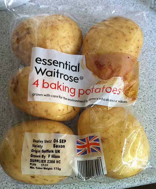 A Waitrose pack labelled 'four baking potatoes' containing five baking potatoes