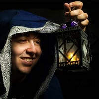 Kid with lantern and robe and a d20 gaming dice