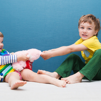 Kids squabble over toys