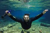 swimming underwater man