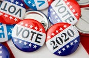 Badges from the 2020 US elections with 'vote' written on them