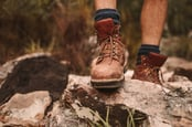 Hiker shoes on rocky trail