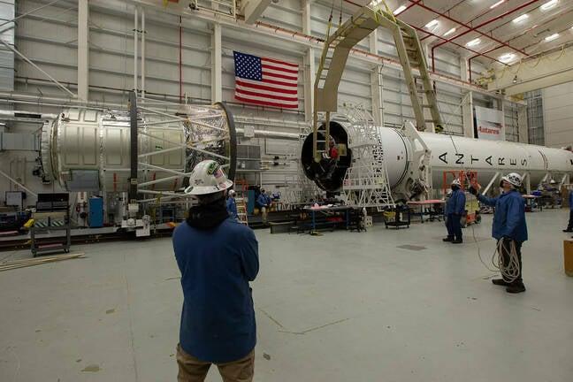 Northrop Grumman staff prepare to mate the company's Cygnus spacecraft with its Antares rocket in the Horizontal Integration Facility at NASA's Wallops Flight Facility in Virginia Monday, Feb. 8, 2021