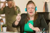Woman singing loudly at work