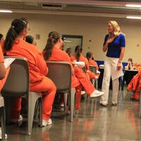 Olympic gold medalist Misty Hyman speaks to Perryville State Prison, Arizona, inmates about making a fresh start in life after their release from prison