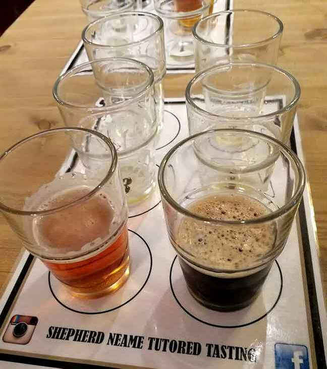 Photo of half-drunk glasses on a table during a beer tasting at the Shepherd Neame Brewery