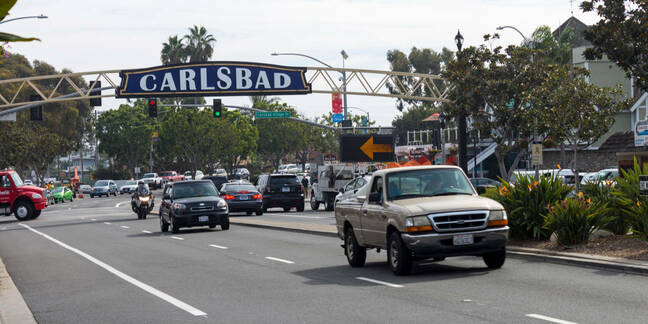 An autumn day on the streets of surfing town Carlsbad city, California - big trucks on the streets